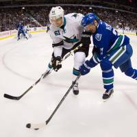Boyle notches OT goal to lift Sharks past Canucks