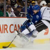 Kings put away Canucks in OT