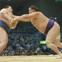 No job for the timid: Shotenro bulldozes Masunoyama at the Kyushu Grand Sumo Tournament on Friday in Fukuoka. | KYODO