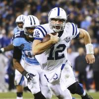 Multifaceted: Indianapolis QB Andrew Luck runs for an 11-yard touchdown against Tennessee in the third quarter on Thursday night. The Colts downed the Titans 30-27 | AP