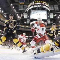 Krejci scores in overtime to lift streaking Bruins past 'Canes