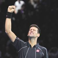 Finishing in style: Novak Djokovic celebrates after his victory over Rafael Nadal in the title match of the ATP World Tour Finals on Monday in London | AFP-JIJI