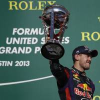 Never gets old: Sebastian Vettel celebrates his eighth straight victory, a new Formula One record, on Sunday. | AP