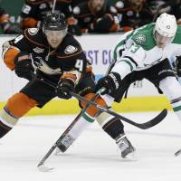 Too late: Anaheim's Cam Fowler (left) passes the puck as Dallas' Valeri Nichushkin defends in the first period on Monday. | AP