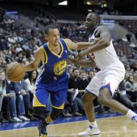 Iguodala, Curry propel Warriors to rout as Sixers receive reality check