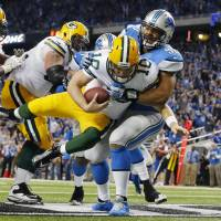 Lions roar back, rout Packers