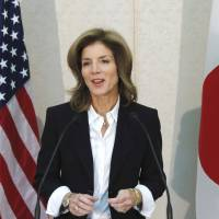 Ready for work: Caroline Kennedy, the new U.S. ambassador to Japan, speaks to reporters after arriving at Narita International Airport on Friday.   | BLOOMBERG