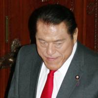 In hot water: Upper House lawmaker Antonio Inoki leaves the chamber after a resolution was passed Wedneday to punish him for visiting North Korea without permission. | KYODO