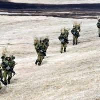 No game: The Ground Self-Defence trains at Camp Narashino in Chiba Prefecture on Jan. 13. The government, in its new defense program guidelines to bolster security in the Senkaku and other islets near China and Taiwan, plans to include the deployment of 300 high-speed combat vehicles armed with cannons. | YOSHIAKI MIURA