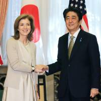 Courtesy call: U.S. Ambassador to Japan Caroline Kennedy meets Prime Minister Shinzo Abe at his residence Wednesday. | POOL