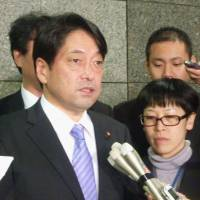 On the same page: Defense Minister Itsunori Onodera speaks to reporters after talking by phone with U.S. Defense Secretary Chuck Hagel. | KYODO
