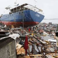 Wrecked: A ship lies washed ashore in Tacloban, Philippines, on Nov. 17 after Typhoon Haiyan. | KYODO