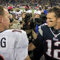 So we meet again: Tom Brady (right) and Peyton Manning will renew their rivalry on Sunday. | AP
