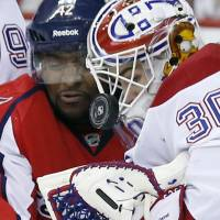 Face to face: Capitals winger Joel Ward (left) and Canadiens goalie Peter Budaj vie for the puck on Friday. | AP