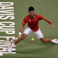 Serbia's Novak Djokovic returns the ball to Radek Stepanek of the Czech Republic during Davis Cup action on Friday in Belgrade | AFP-JIJI