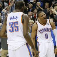 All or nothing: Thunder guard Russell Westbrook (right) celebrates with Kevin Durant after hitting the game-winning shot in OT on Friday. | AP