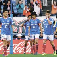 We blew it: Yokohama players leave the pitch after a 2-0 defeat against Albirex Niigata on Saturday in Yokohama. | KYODO