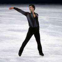 <B>Only the best: Patrick Chan performs his short program at the Trophee Bompard on Friday | CHAN BROKE HIS OWN WORLD RECORD WITH A  SCORE OF <A HREF=