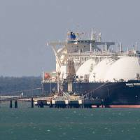 Fill 'er up: A liquefied natural gas tanker operated by Energy Advance Co., a unit of Tokyo Gas Co., is moored at the ConocoPhillips LNG facility in Darwin, Australia, in April 2012. Australia is Japan's top source of LNG. | BLOOMBERG