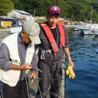 Coastal village tries to catch young fishermen