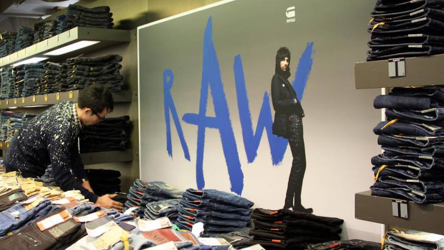 Beyond denim: A manager at G-Star RAW Store Tokyo Shibuya arranges jeans before the shop opens on Nov. 21. An employee from the store took the exam for Japan's first 'jeans sommelier' certification exam earlier this year.