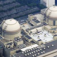 Two's a crowd: Two reactor buildings at Kansai Electric Power Co.'s nuclear plant in Oi, Fukui Prefecture, are shown in July. | KYODO