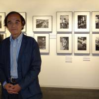Record keeper: Freelance photographer Shisei Kuwabara, 77, makes an appearance at his exhibition on Minamata disease in the Nikon Salon in Chuo Ward, Tokyo, last week | KYODO