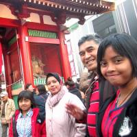 Make yourself at home: Muslims from Malaysia, Azlina Ahmad Azman (third from right) and her family visit Asakusa during their first stay in Tokyo earlier this month. | KYODO