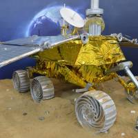 Jumping over the moon: A model of China's Yutu (jade rabbit) lunar rover, set to be launched in early December, is displayed at the China International Industry Fair 2013 in Shanghai at the beginning of this month. | AFP-JIJI