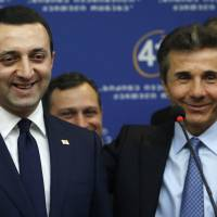 Handpicked: Georgian Prime Minister Bidzina Ivanishvili (right) presents his successor, Irakli Garibashvili, during a news conference in Tbilisi on Saturday | AP
