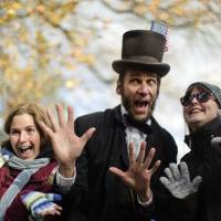 Oration for the ages: An actor portraying Abraham Lincoln poses for photos Tuesday in Gettysburg, Pennsylvania, after a ceremony commemorating the 150th anniversary of the 16th president's delivery of the Gettysburg Address. | AP