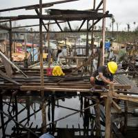 Typhoon-hit towns begin rebuilding