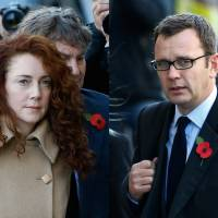Power lovers: Former News of the World editor Rebekah Brooks (left) and her husband, Charlie Brooks, and former News of the World editor Andy Coulson arrive at The Old Bailey law court in London on Monday. On Thursday, a prosecutor in Britain's phone hacking trial revealed that Brooks and Coulson — the two most senior U.K. tabloid editors accused of illegal eavesdropping and bribery — had a secret affair lasting at least six years | AP