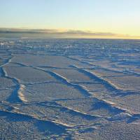 Thinning ice: Fracture lines are intensified when sunlight heats the sea ice in Antarctica, as seen in this photo taken by University of Colorado researchers in 2003. | AP
