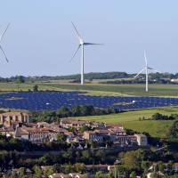 Natural energy: Wind turbines and a solar park are seen near the Midi-Pyrenees village of Avignonet-Lauragais on May 26. | AFP-JIJI