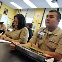 U.S. Navy throws cash at struggling schools