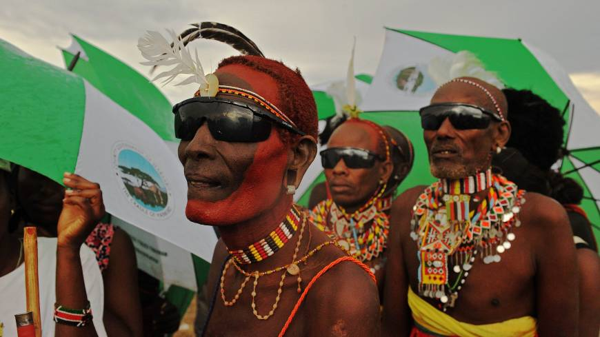 Heavenly hybrid: Men from the Rendile tribe observe a rare solar eclipse in the Sibiloi national Park in Turkana on Sunday. Astronomy enthusiasts in Kenya caught a partial glimpse of a rare 'hybrid total eclipse,' which hasn't been witnessed in Africa in over 40 years, though weather hampered a view of the complete eclipse
