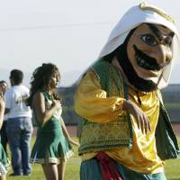 Gimme an 'A'!: Coachella Valley High School's Arab mascot dances during a pep rally in Thermal, California, in 2005 | AP