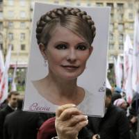 Not forgotten: A supporter of former Ukrainian Prime Minister Yulia Tymoshenko attends a protest outside the Kiev City Council building in October. | AP