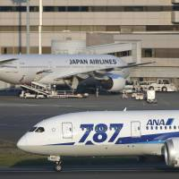 Straight and level: ANA, JAL and Peach Aviation flights on Wednesday flew through China's newly declared air defense identification zone without notifying the country after the Japanese government asked airlines to stop giving flight information to China. | BLOOMBERG