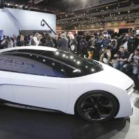 Hydrogen kick: Honda's sleek FCEV Concept vehicle is unveiled at the Los Angeles Auto Show on Wednesday. | AP