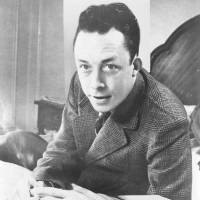 Literary legend: Author Albert Camus smokes a cigarette in 1957 in a photograph from the New York World-Telegram and Sun Newspaper collection. | WIKIPEDIA