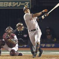 Dramatic blast: The Giants' Jose Lopez smacks a two-run home run in the fifth inning off Eagles ace Masahiro Tanaka in Game 6 of the Japan Series at Kleenex Stadium on Saturday night. Yomiuri beat Tanaka and Tohoku Rakuten 4-2 to force a Game 7 on Sunday. | KYODO