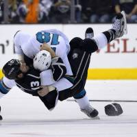 Kings beat Sharks on overtime goal