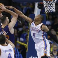 Start again from zero: Oklahoma City's Russell Westbrook (0) blocks a shot from Phoenix's Miles Plumlee during the Thunder's 103-96 win on Sunday. | AP