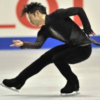 In control: Daisuke Takahashi performs during the men's short program at the NHK Trophy on Friday at Yoyogi National Gymnasium. Takahashi leads the field with 95.55 points. | AFP-JIJI