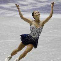 Bronze age: Akiko Suzuki performs on her way to a third-place finish at the NHK Trophy on Saturday. | AP