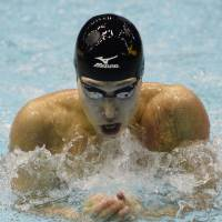Hagino strikes gold in World Cup 100 medley