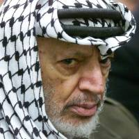 Mystery remains: Palestinian leader Yasser Arafat attends Friday prayers in his headquarters in the West Bank city of Ramallah on May 31, 2002 | AP