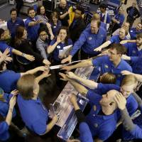 Those about to sell, salute: Best Buy employees rally after a pep talk as they prepare to open the store Thursday in Overland Park, Kansas. Instead of waiting for Black Friday, which is typically the year's biggest shopping day, more than a dozen major retailers opened on Thanksgiving this year. | AP